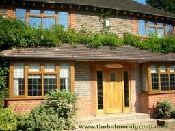 Oak UPVC Windows With Real Oak Timber Front Door & Side Lights