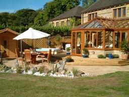 A Gardinia Conservatory with a Garden and Hot Tub