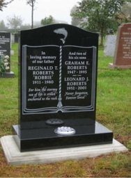 Black granite memorial with etched design