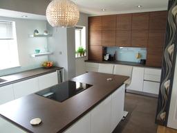 Gloss white and book-matched Walnut kitchen
