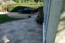 Mr & Mrs Bull's patio laid with three different sized slabs and block paving edge