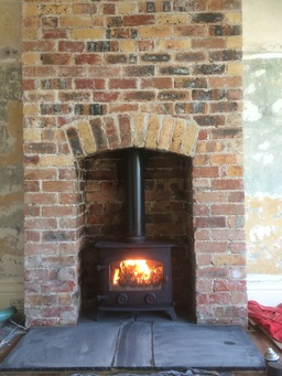 Chimney breast built by us to install the stove.