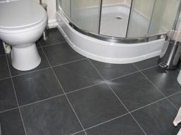 Tile-effect Laminate Flooring installed in an en-suite bathroom