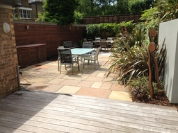 decking and sandstone patio