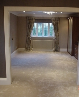 Bedroom with white saxony carpet installed