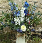 Jug of freshly picked delphiniums and stocks