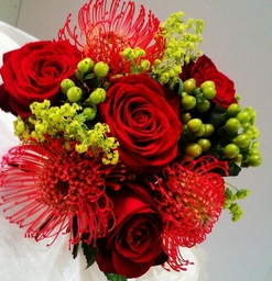 Wedding Hand tie of red roses and green hypericum