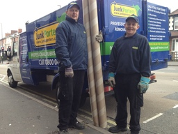 rubbish removal team in Derby clearing up waste.