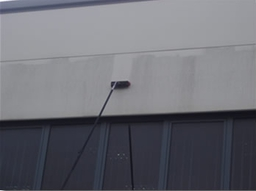 Roger Needle's team cleaning a companies cladding