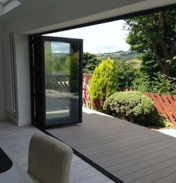 The completed project - a classic installation of our Visofold bi fold doors and a very happy customer.