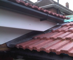 Roof/stage 3,lead work and abutment to existing re-tiled roof detail
