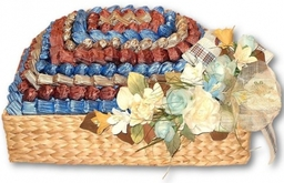 Handwrapped French chocolate in a basket decorated with hand-made Italian silk flowers.