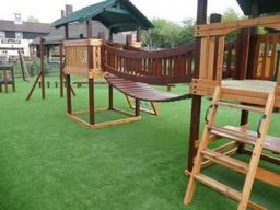 Synthetic grass pub play area in Wiltshire using Namgrass artificial turf.