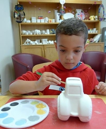 Boy Painting Tractor