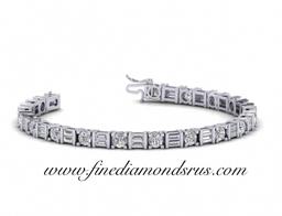 Round And Baguette Cut Diamonds Tennis Bracelet in Platinum at Fine Diamonds R Us