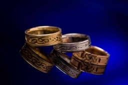 Celtic gold wedding rings in three precious metal alloy colours