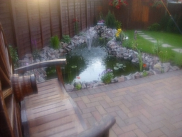 block paved patio , landscaped garden including turfing , fencing and pond all done by lmt paving and landscapes loughborough , leicestershire . Tel 01509 264303