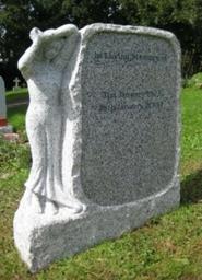 Carved figure on light grey granite boulder