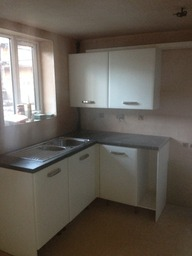 kitchen fit with masons mitre worktops
