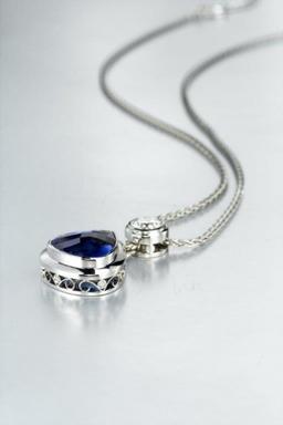 Multi award winning Bespoke Platinum , Tanzanite and diamond pendant
