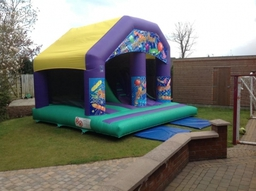 New 17ft x 17ft Play And Slide, has steps and a big slide all enclosed inside the castle.