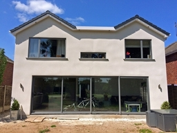 A very stylish Visoglide triple track sliding door scheme and Heritage 47 windows recently installed into a private house development in Wilmslow, Manchester.