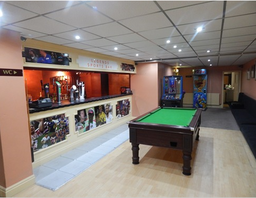 'Legends Sports Bar' with full-sized pool table/Digital jukebox and Games area.
