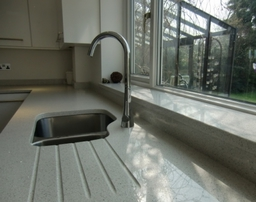 Caesarstone Quartz Reflections worktop with drainer groves, under sill and sill for a complete finish