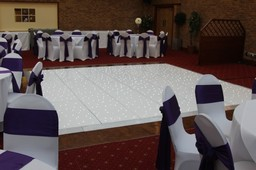 White lede dance floor and Chair Covers