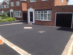 After - tarmacadam with block paved border