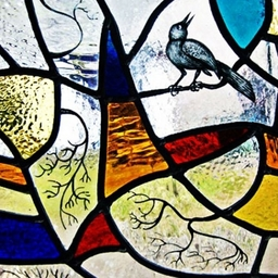 Blackbird design stained glass for a house near Perth designed and made by Artisan Stained Glass