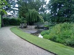 A landscaped garden with a brook running through it