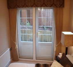 Double hinged units over a pair of French doors gives full unimpeded access