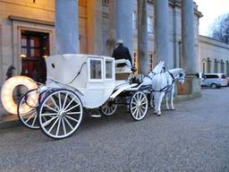 Our white Wedding Carriage can be open or closed