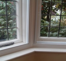 Close up of secondary glazing fitted in a bay window