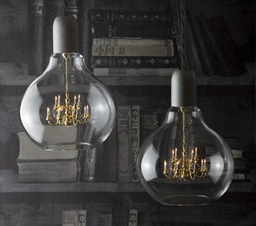 The 'King Edison' pendant lamp designed by Young & Battaglia, combines the pure simplicity of an Edison light bulb with the romance and glamour of a Kings chandelier. It consists of a miniature brass chandelier inside a hand blown clear glass.
