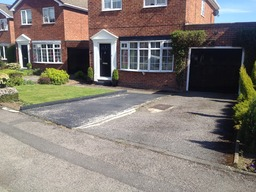 Before - Tarmacadam with block paved border