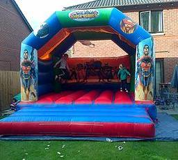 SUPER HEROES BOUNCY CASTLE 15 X 15FT This Bouncy Castle is suitable for Children and Adults The castle will hold 8 to 10 users at a time The Castle has a sewn in rain cover which is suitable for light rain The required space needed for this Bouncy Castle