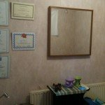 Certificates on treatment room wall