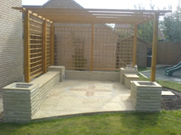 Patio and pergola with walls, seating and plant boxes