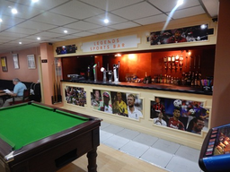 'Legends Sports Bar' showing live sport daily and serving residents 24 hours a day.