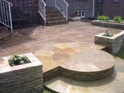 Indian sandstone garden paving and walling in Wiltshire. The product used was Pavestone's Raj Blend Indian sandstone.