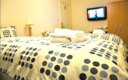 A twin room at Heathrow Lodge
