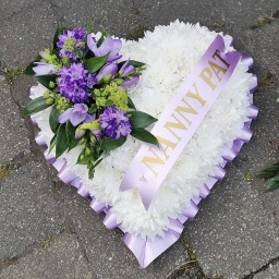 Funeral tribute heart purple flowers