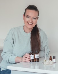 Lib's Aromatherapy owner with products