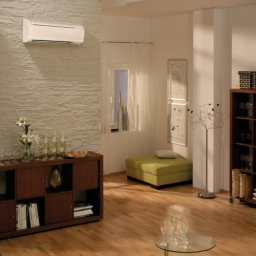High Level Wall Mounted Air Conditioning Unit In A Residential Family Room