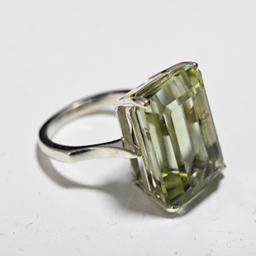 Green gemstone cocktail ring emerald cut