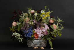 Wild wedding floral basket for a side table