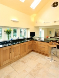 Bespoke oak  kitchen with uba tuba granite