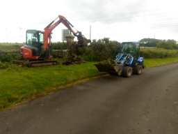 mini digger and Multione working together
